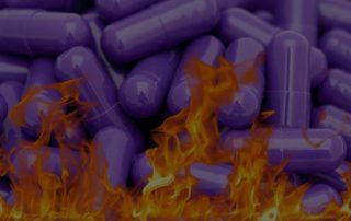 purple pills in flames