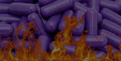 purple pills in flames